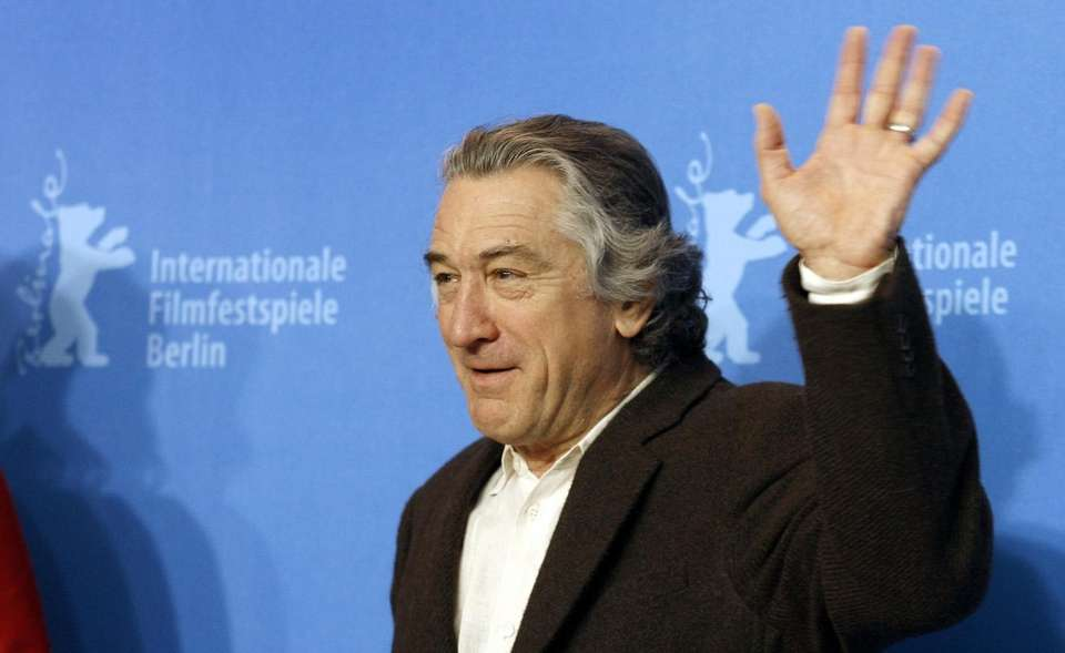 Robert De Niro waves during a photo session
