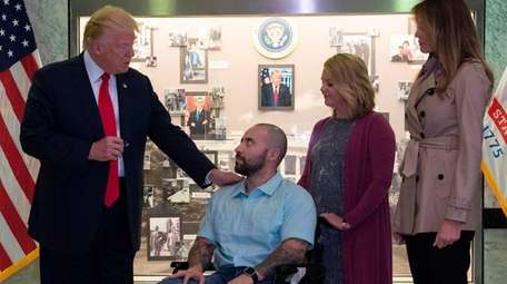 President Donald Trump awards a Purple heart to