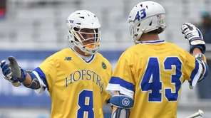 Jimmy Yanes #8 of Hofstra University, left, gets