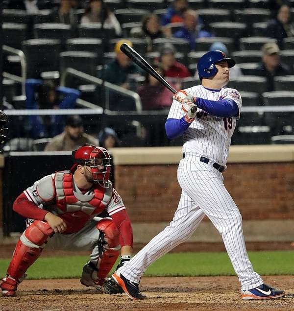 Jay Bruce of the Mets follows the