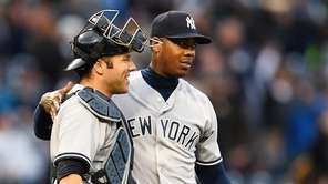 Aroldis Chapman #54 celebrates with Austin Romine #27