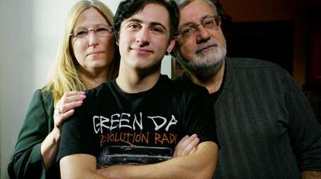 Alex Bacaris, 18, with his parents Theresa