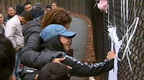 Mourners gathered at the park across Central Islip