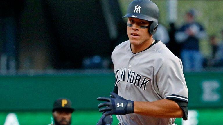 New York Yankees' Aaron Judge rounds second past