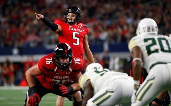 Texas Tech quarterback Patrick Mahomes II (5) calls