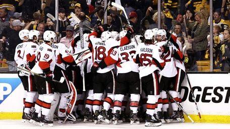 Members of the Ottawa Senators celebrate with Clarke