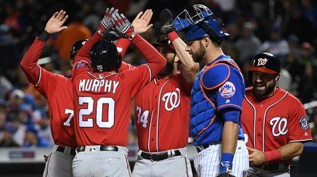 Washington Nationals second baseman Daniel Murphy is met