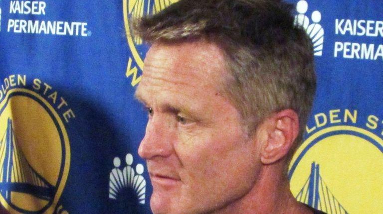 Golden State Warriors coach Steve Kerr speaks to