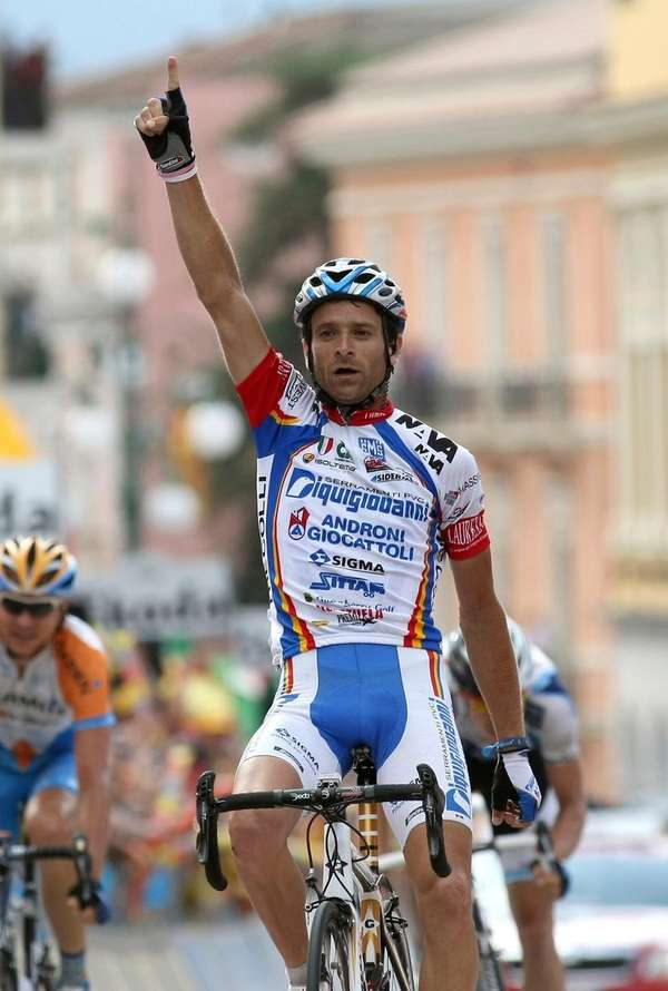 Michele Scarponi crosses the finish line of the
