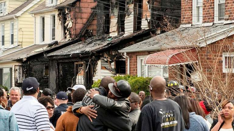 FDNY firefighters work at a house fire at