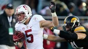 Christian McCaffrey  of the Stanford Cardinal runs away