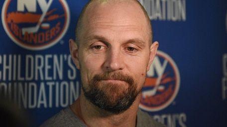 New York Islanders defenseman Dennis Seidenberg answers questions