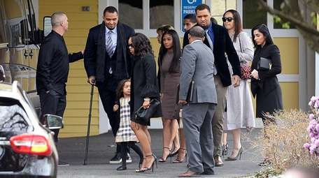 Shayanna Jenkins Hernandez, front, fiancee of former New