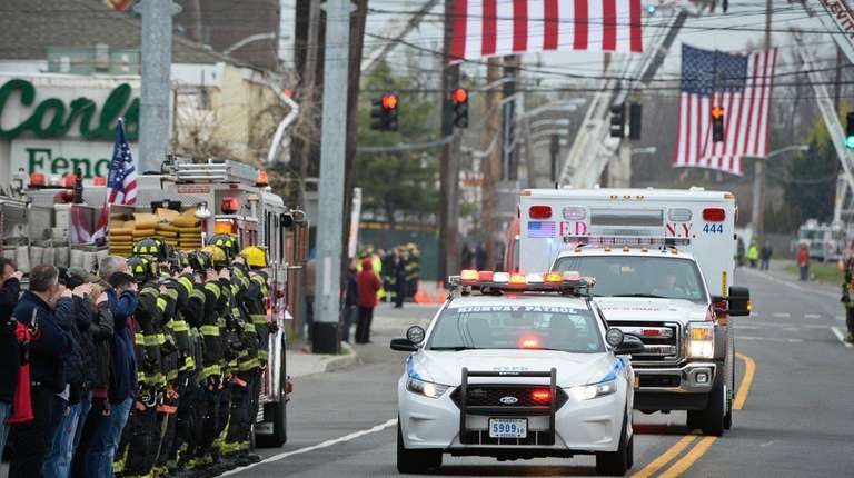 A procession makes its way down Hicksville Road