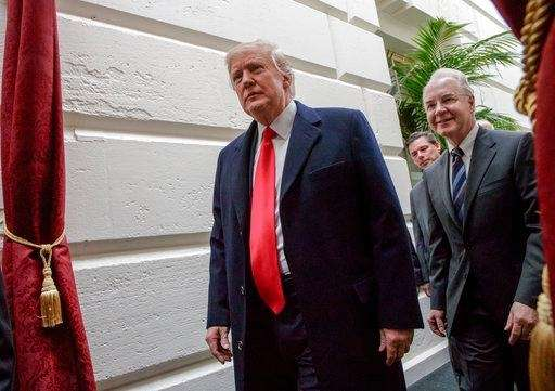 President Donald Trump leaves Capitol Hill in Washington