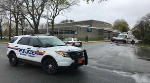 During a lockdown, Nassau County police cars are