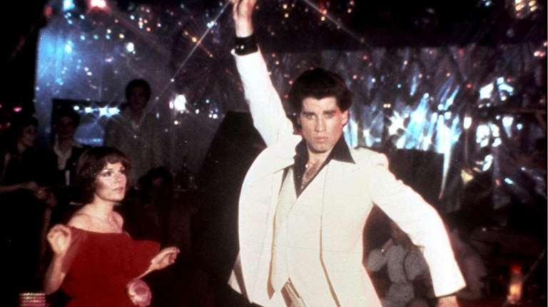 John Travolta strikes his iconic dance pose with