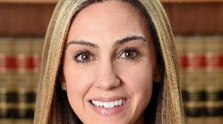 Laura J. Mulholland of Bayport has been hired