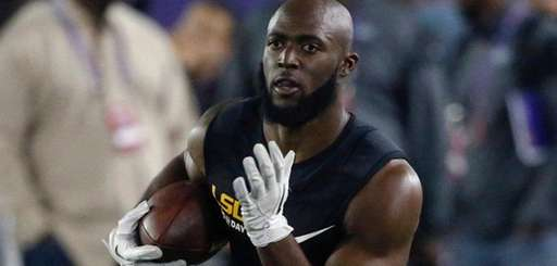 Running back Leonard Fournette runs through drills during
