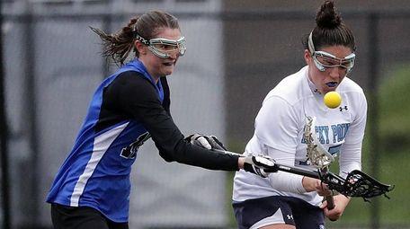 Rocky Point's Alyssa Moscatiello (15) checks the ball