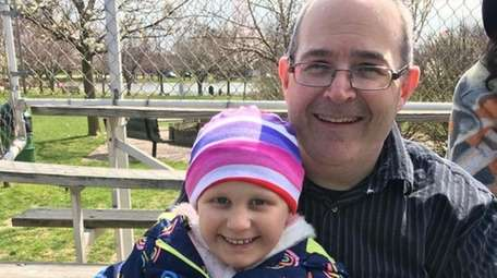 Dan McCarthy and his daughter Cassidy, 5, who