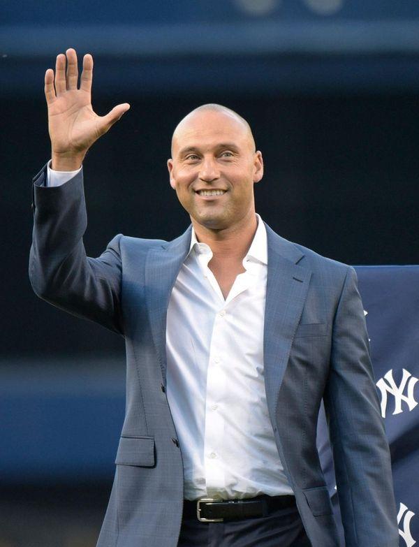 Yankees' Derek Jeter waves to fans as he