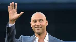 Yankees' Derek Jeter waves to fans as he