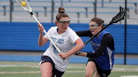 Rocky Point's Madison Sanchez drives against Hauppauge's Katie