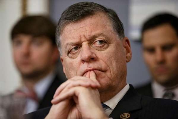 Rep. Tom Cole, R-Okla. listens on Capitol Hill