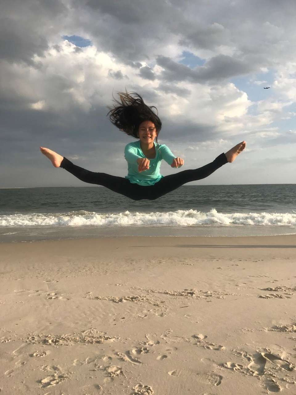 Sophia Cerky Flying high at Point Lookout Beach