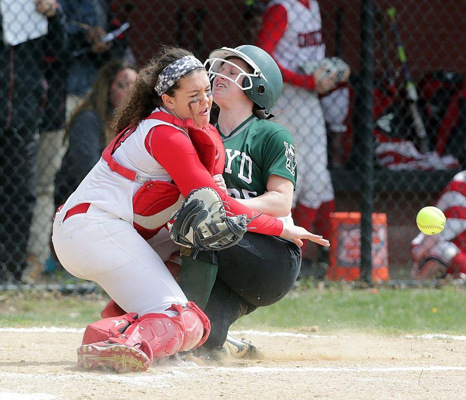 Floyd's Johanna Metz (25) collides with Connetquot catcher