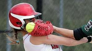 Connetquot's Julianna Prescia (6) collides with Floyd shortstop