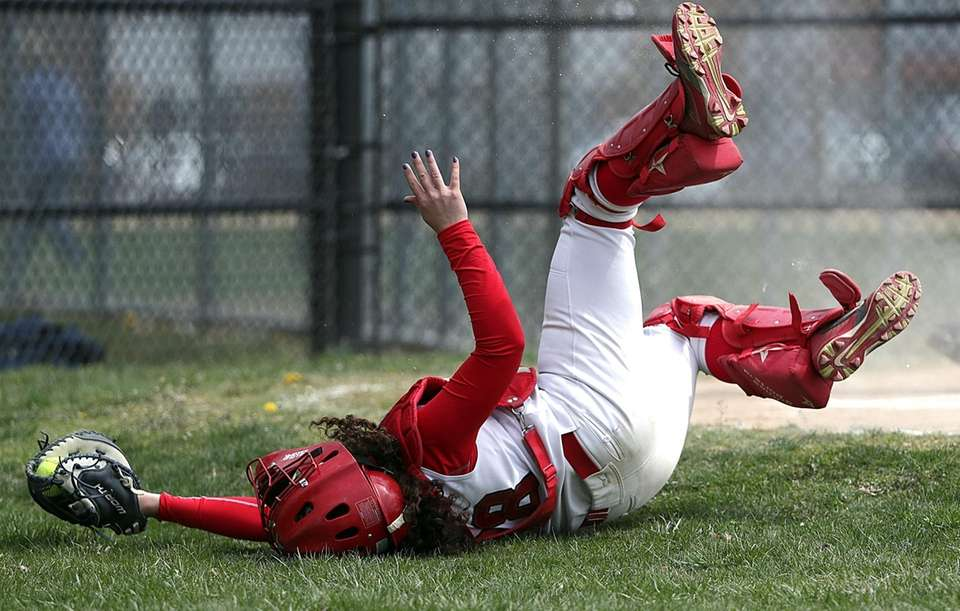 Connetquot catcher Ashley Spencer (28) makes a leaping