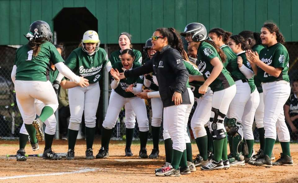 Brentwood's Priscilla Rivera is greeted by her teammates