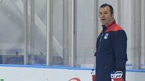 New York Rangers head coach Alain Vigneault directs
