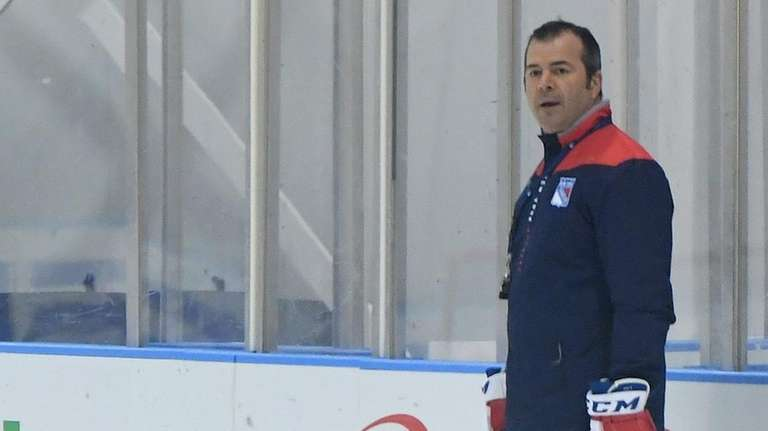 New York Rangers head coach Alain Vigneault directs