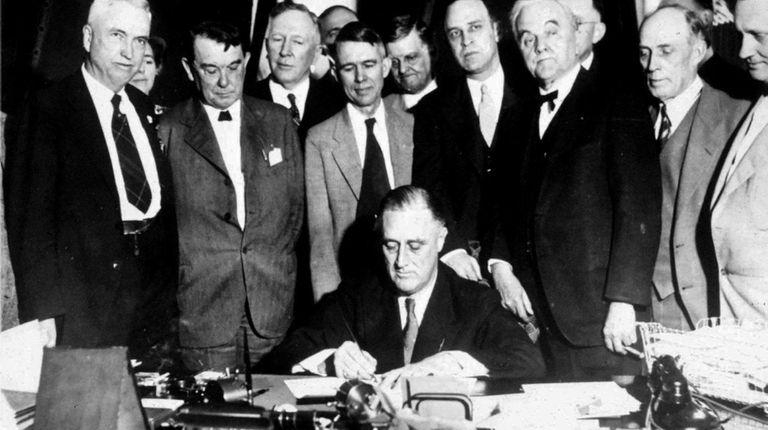 President Franklin D. Roosevelt is shown signing a