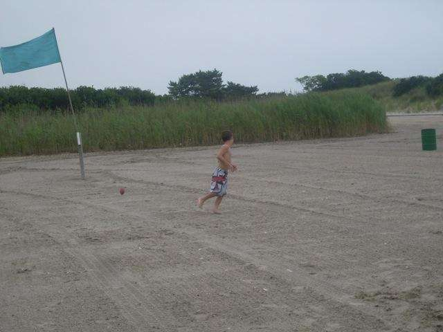 A young boy throws around a football at