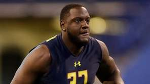 Alabama offensive lineman Cam Robinson runs a drill