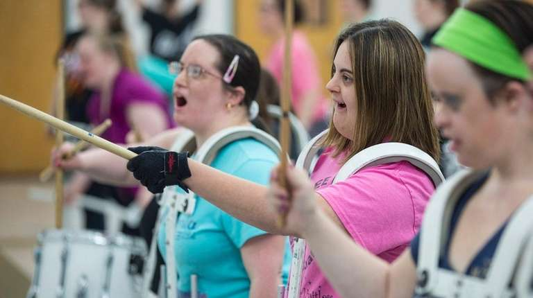 Carly Schoenfeld, center, of Merrick, rehearses during drum