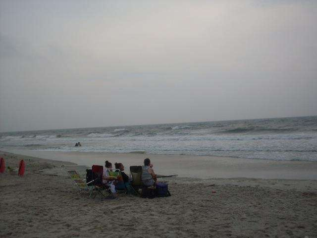 A family enjoys a late afternoon at Tobay