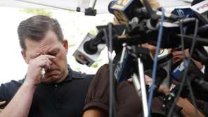 Daniel Schuler cries while his sister-in-law, Jay Schuler,