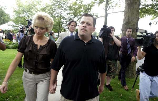 Daniel Schuler walks with his sister-in-law, Jay, after