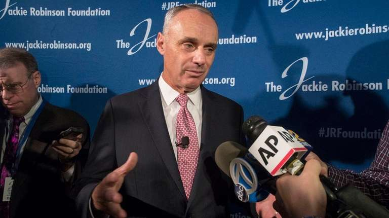 MLB Commissioner Robert ManfredJr.speaks to reporters after a
