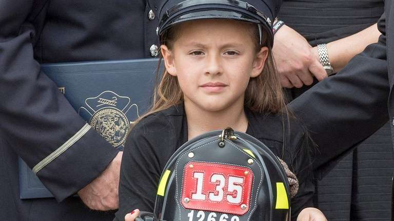 FDNY firefighter William N. Tolley's daughter holds a