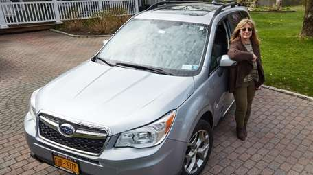 Dawn Oates with her Subaru Forester at her