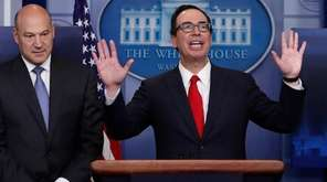 Treasury Secretary Steven Mnuchin, right, joined by National