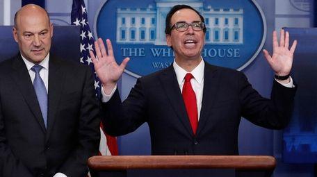Treasury Secretary Steven Mnuchin, right, joined by National