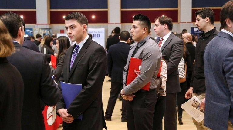 Stony Brook University students speak with recruiters during