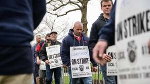 Workers from Teamsters Local 812 picket at beer